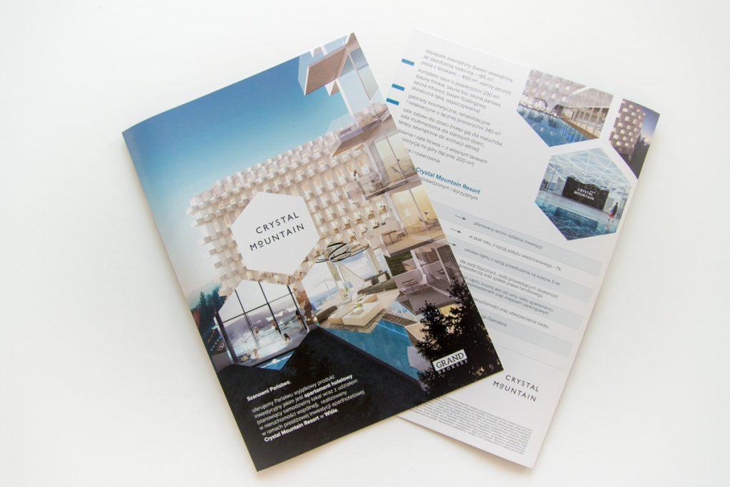 Folder ofertowy sprzedaży apartamentów. Projekt z drukiem folderu dla Grand Brokers z ofertą apartamentów hotelowych w prestiżowej inwestycji aparthotelowej Crystal Mountain Resort w Wiśle.